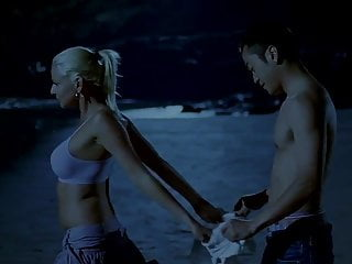 Chinese man and white girl on the beach (2007)