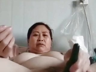 mature chubby Chinese woman with veggie