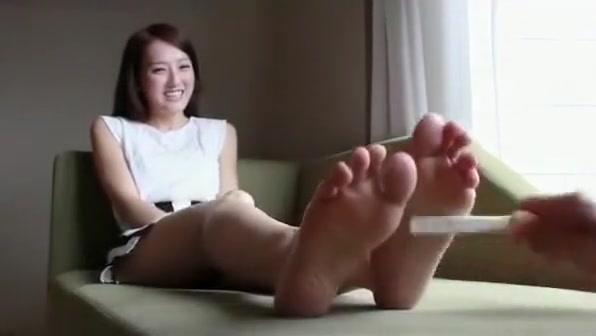 Tickling pretty Chinese girls feet