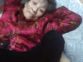 Chinese granny's huge clit
