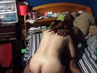 Chinese Lady takes a black penis on bed