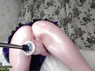 Asian squirts from a sex machine in a tight pussy