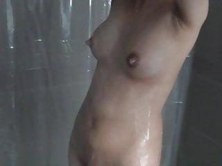 Post pregnancy engorged breast feeding wife taking a shower