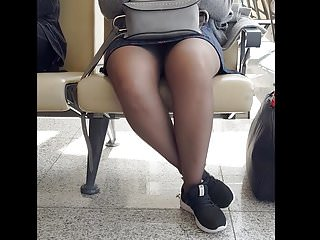 Chinese girl in grey pantyhose and mini skirt with faceshot