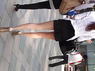 Extremly sexy girl in short skirt spying
